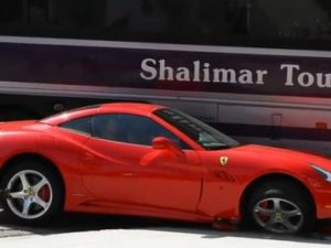 Ferrari California crashes into Tour Bus